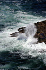 Water splashing over rocky outcrops in ocean at Esha Ness.