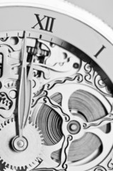 black and white close view of watch hands and mechanism