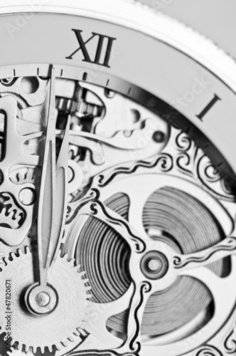 Leinwanddruck Bild black and white close view of watch hands and mechanism