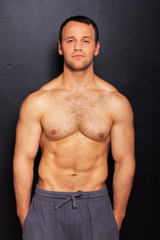Handsome man with naked torso posing