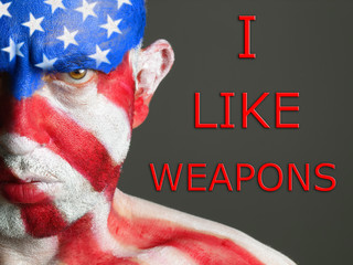 Man face flag USA, I like weapons, serious expresion