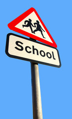 school warning sign on blue sky background