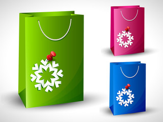 Paper bags with paper snowflakes.