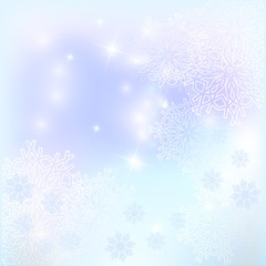 Winter background. Snowflakes and glare.