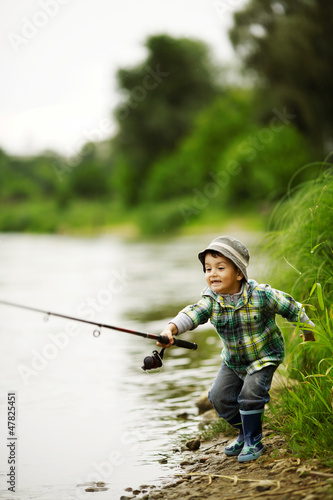 photo of little boy fishing