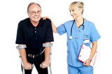 Cheerful doctor encouraging her patient to walk with crutches poster