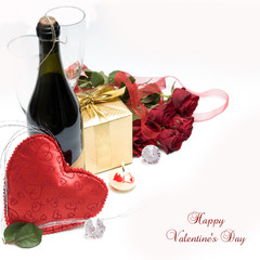 Romantic still life with fruity  sparkling wine,gift and roses
