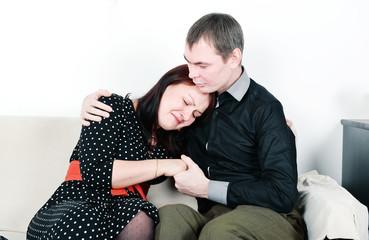 Man comforting her woman