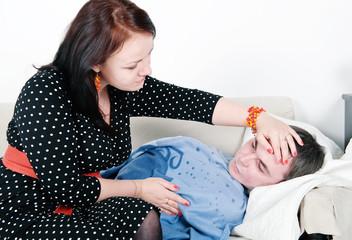 Woman comforting her sick man