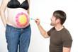 Schwangerschaftsbauch bemalen