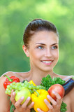 happy beautiful young woman with vegetables