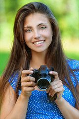 happy beautiful young woman with camera