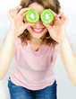 Funny woman holding kiwis fruit for her eyes. Isolated on white