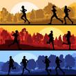 Marathon runners in wild forest nature