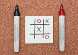 tic tac toe game with red and black markers
