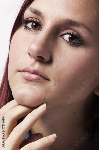 A Beautiful Young Redhead in Thought