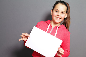 Beautiful little girl with blank paper