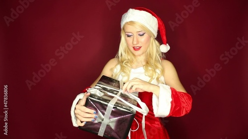 Santa girl dances with present