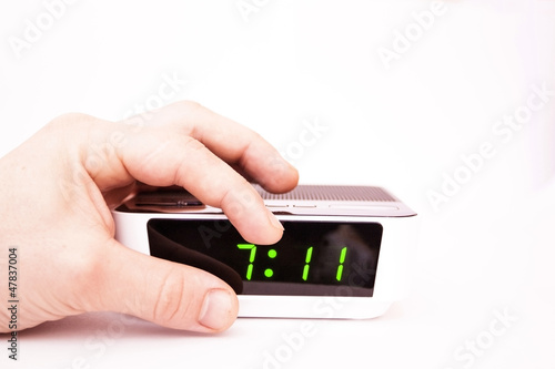 Contact of a hand of an alarm clock