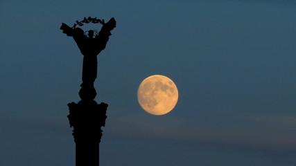 Ukraine Independence monument Kiev moonrise