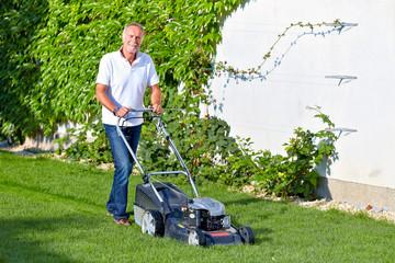 Senior man is cuting the grass 2
