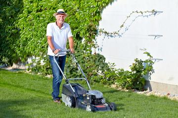 Senior man is cuting the grass 3
