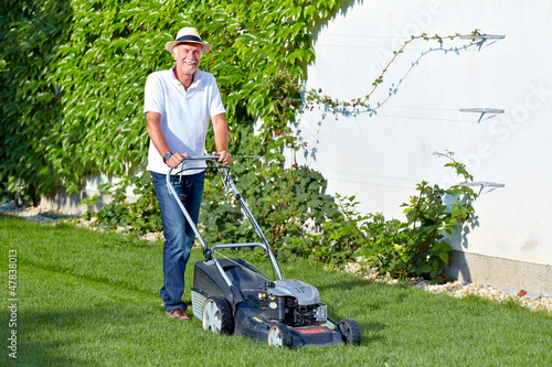 Senior man is cuting the grass 3