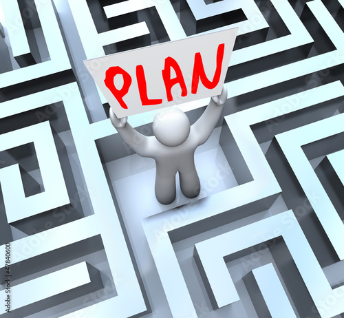 Plan Man Holding Sign in Maze Labyrinth