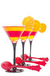 Yellow and red  fruit jelly with orange slice, with red spoons,