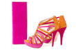 Pare of pink and orange shoes and a matching bag, isolate on whi
