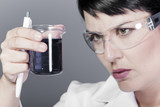 A medical or scientific researcher or doctor looking at a liquid