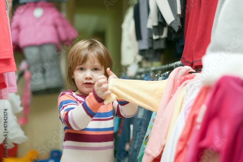 2 years baby in clothes shop