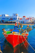 Colorful wooden fishing boats front view Mykonos island old port