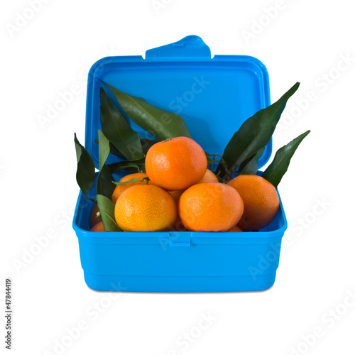 Box of tangerines is isolated on a white background.