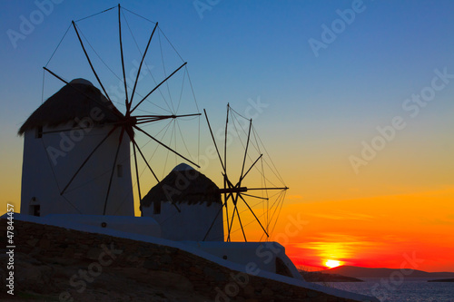 Windmills sunset in Mykonos Island Cyclades Greece © korpithas