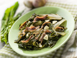 boiled swiss chard salad with anchovy and garlic selective focus