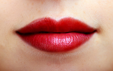 closeup of beautiful red lips of a young girl