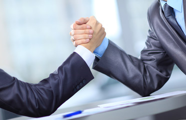 Two businessmen press hands each