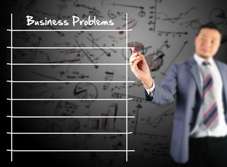 Business man writing business problem