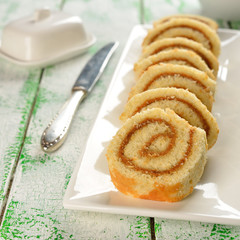 Rolls with cream on a white table