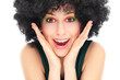 Surprised woman with afro wig