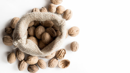Walnuts with Bag on white Background