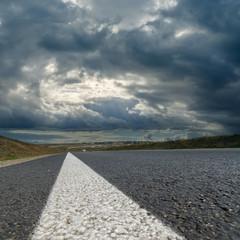 dramatic sky over asphalt road