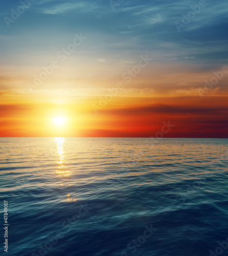 red sunset over dark water