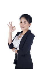businesswoman indicating OK sign isolated on white background