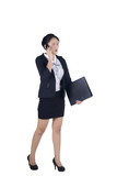 Angry face of business woman walking talking on mobile phone.