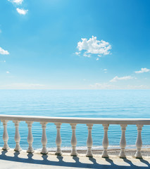 balcony near sea under blue sky