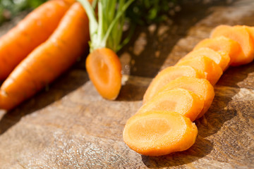 washed and fresh  carrot on cutting board, outdoors