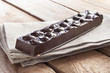 Delicious chocolate bar with almonds on canvas