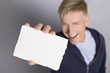 Cheerful man showing blank white card.